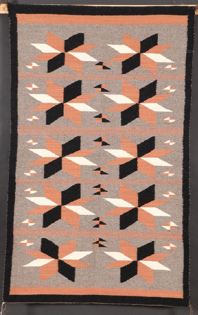 A GROUP OF FOUR SOUTHWEST NAVAJO HANDWOVEN RUG