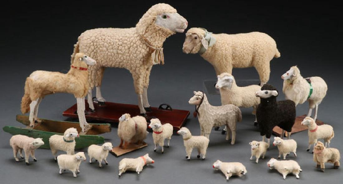 A COLLECTION OF 21 VINTAGE SHEEP FIGURES