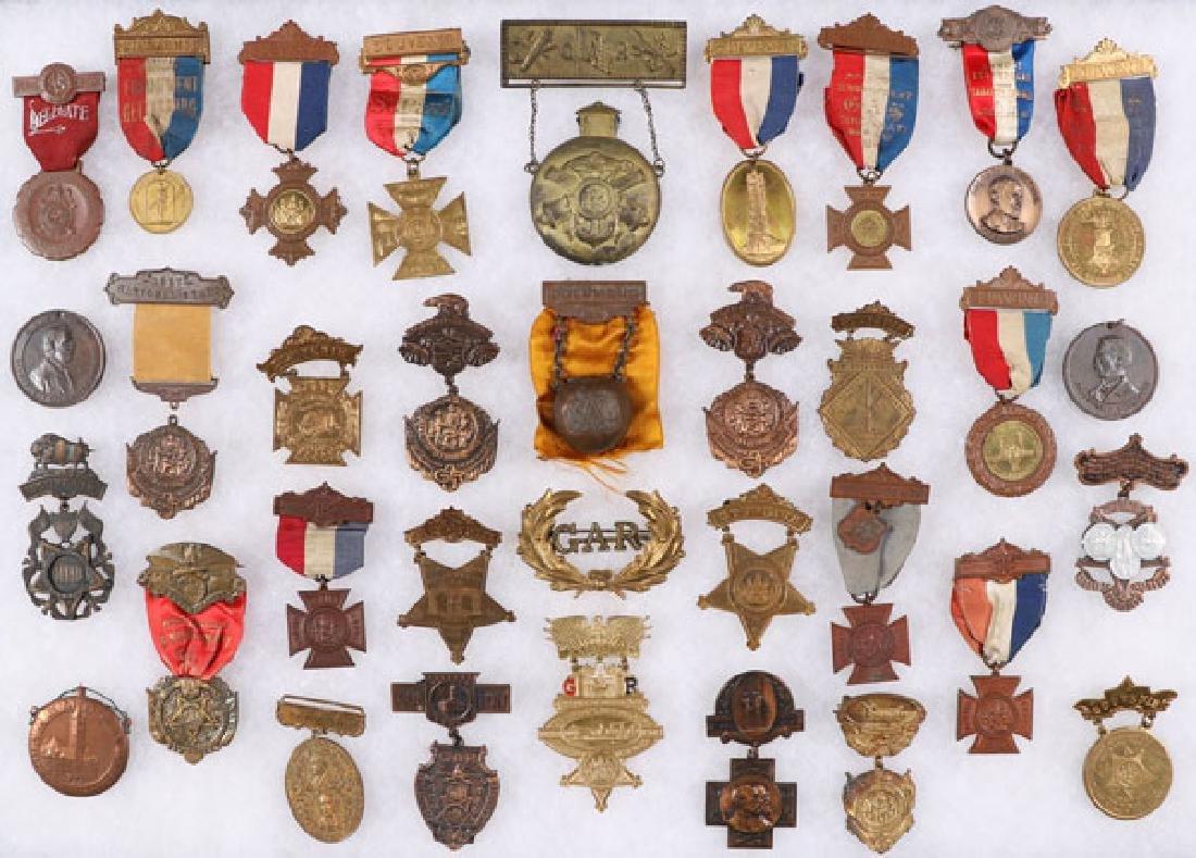 A GROUP OF 30 CIVIL WAR GAR BADGES