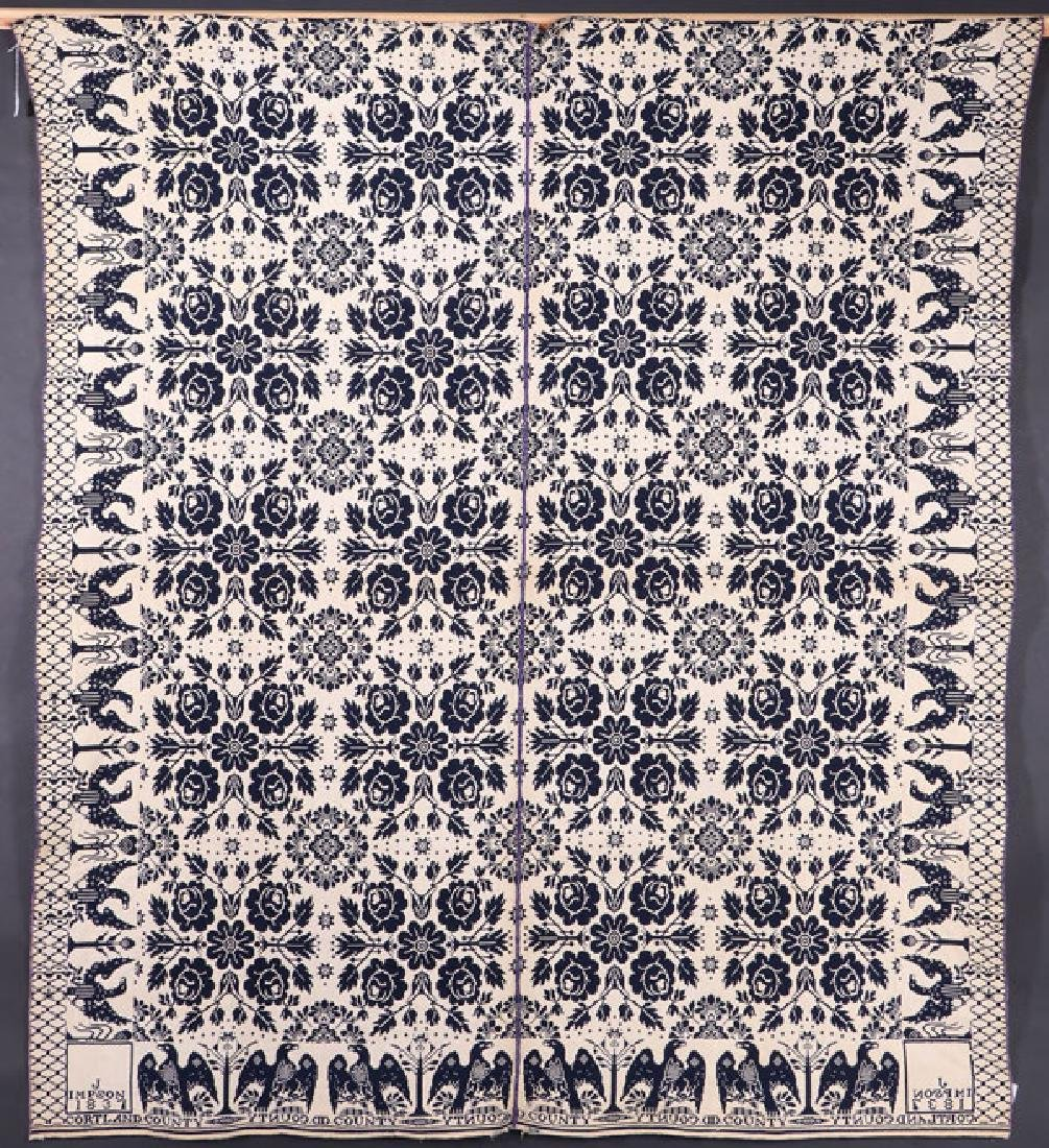 A BLUE AND WHITE COVERLET MADE BY JACOB IMPSON