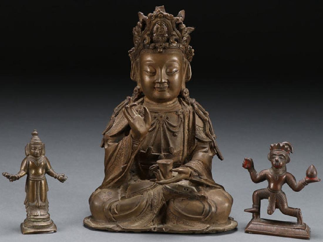 A GROUP OF THREE SINO-TIBETAN BRONZE DEITIES