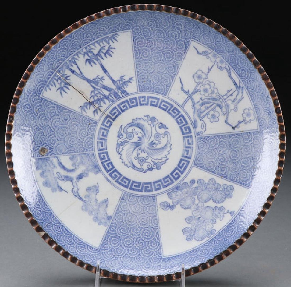A CHINESE BLUE AND WHITE DECORATED CHARGER