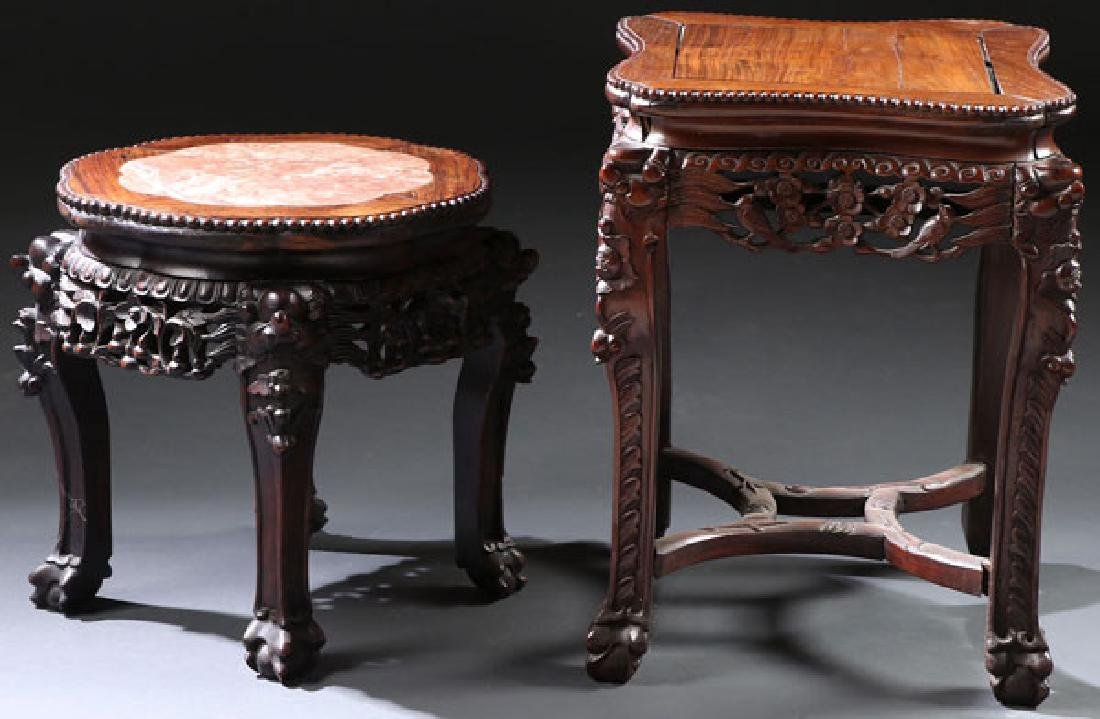 A PAIR OF CHINESE EXPORT CARVED HARDWOOD STANDS