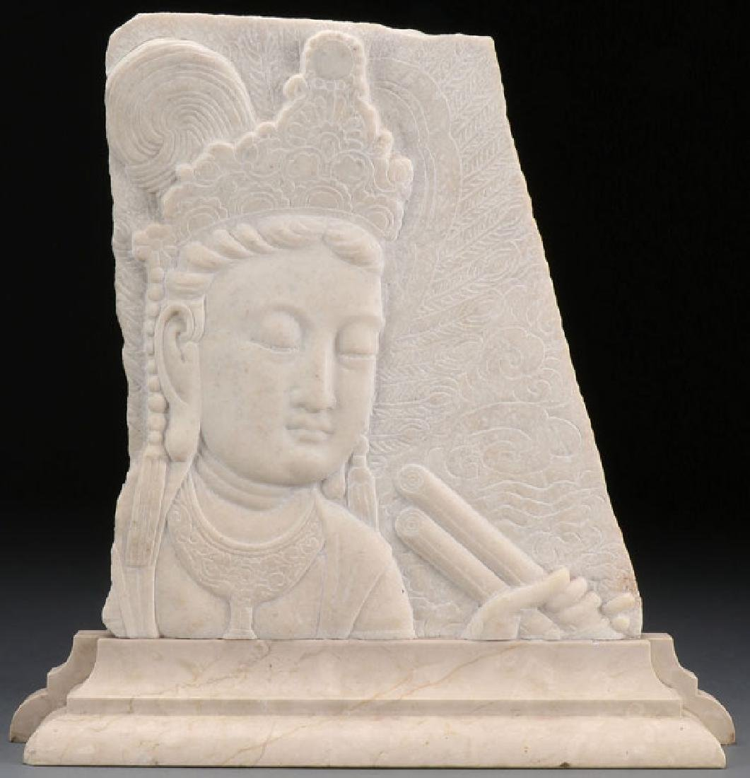 A LARGE SINO-TIBETAN CARVED LIMESTONE STELE