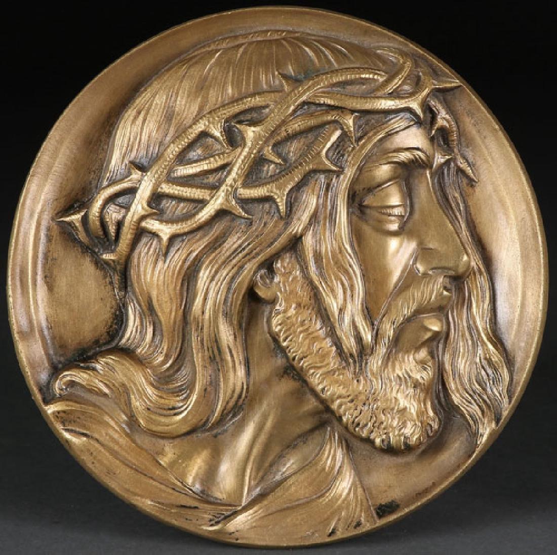 A CAST BRONZE RELIEF PLAQUE OF CHRIST