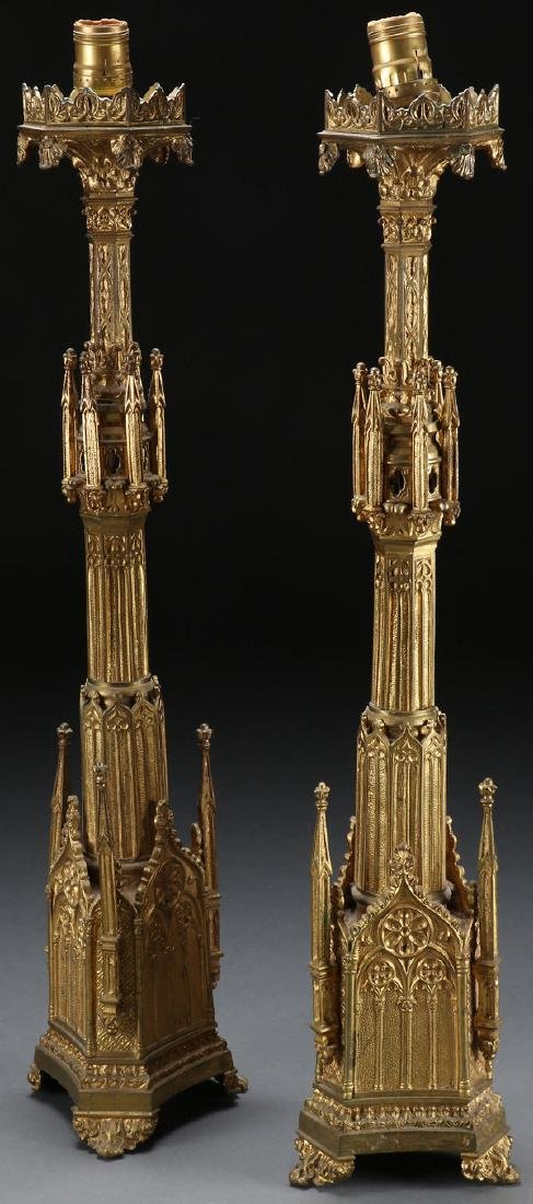 A PAIR OF GILT BRONZE GOTHIC STYLE CANDLE STANDS