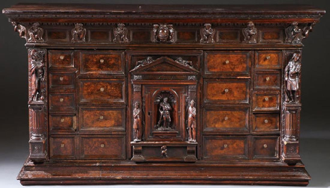 AN ITALIAN FIGURAL CARVED WOOD BAMBOCCI CABINET