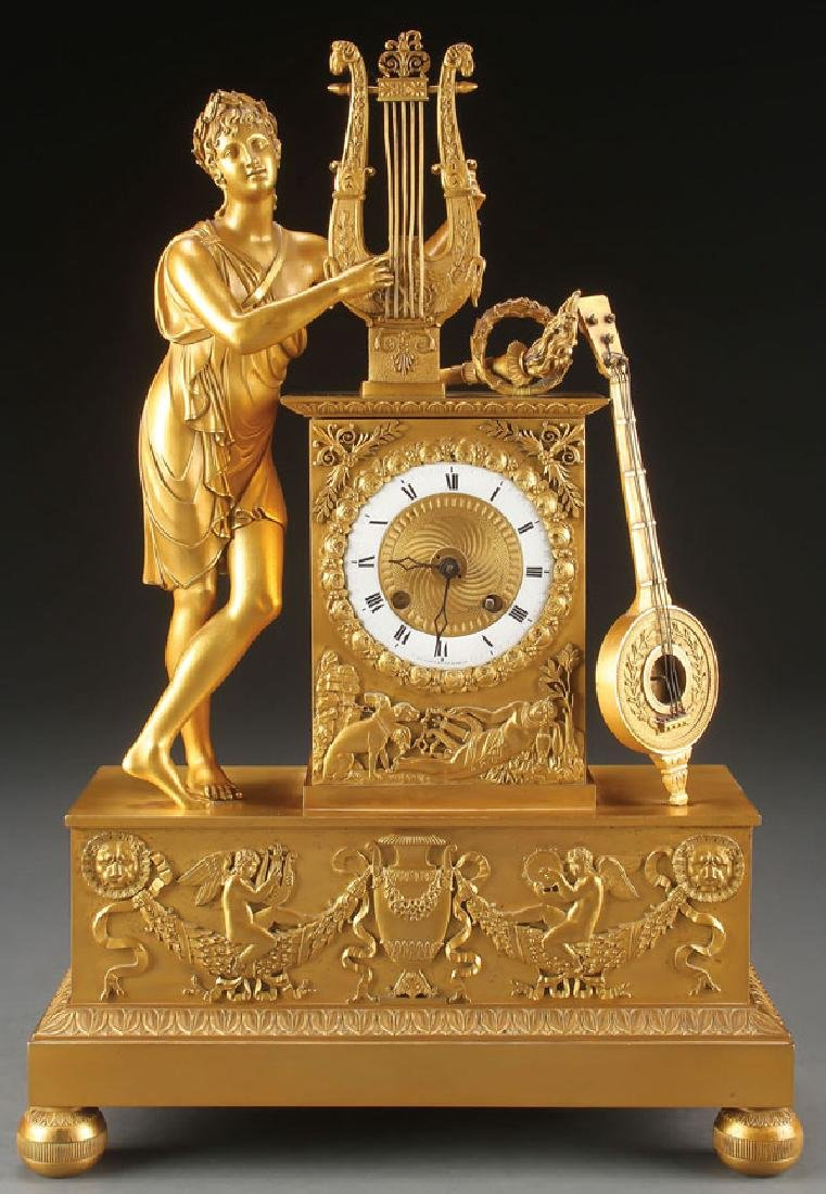 A FINE FRENCH EMPIRE GILT BRONZE MANTLE CLOCK