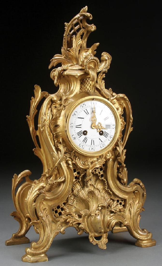 A FRENCH ROCOCO BRONZE MANTLE CLOCK, 19TH CENTURY