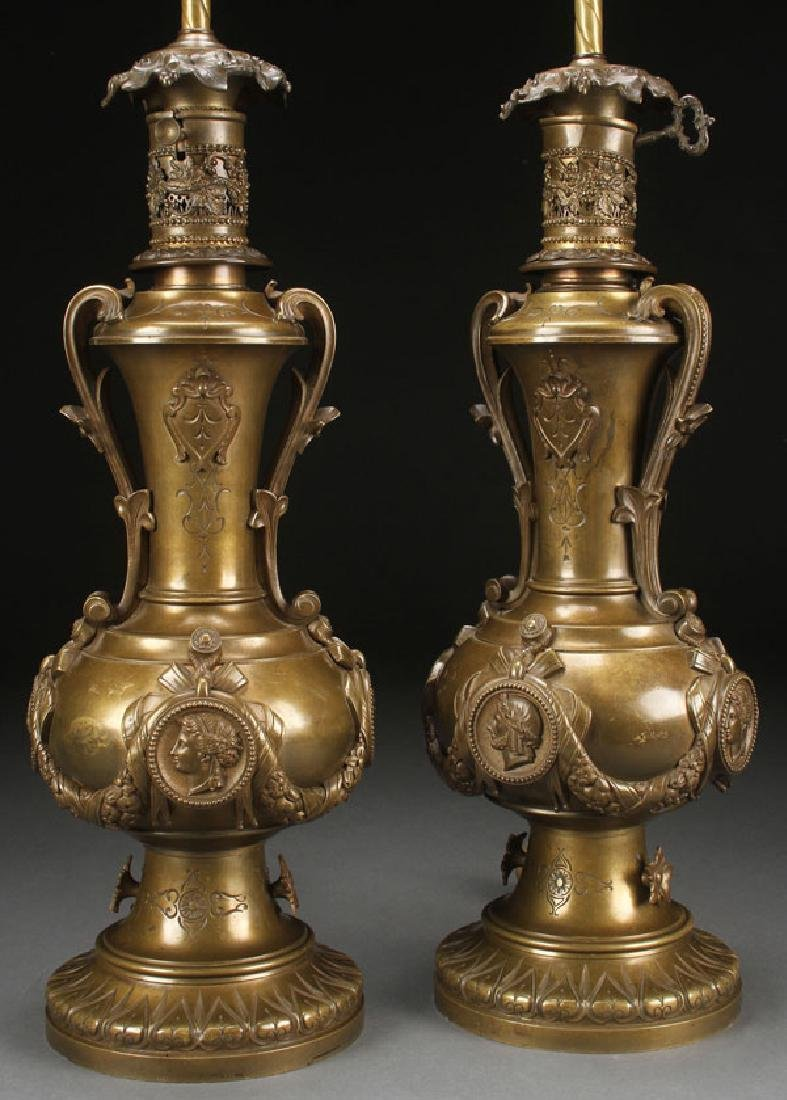 A PAIR OF BRONZE AESTHETIC OIL LAMPS, 19TH C