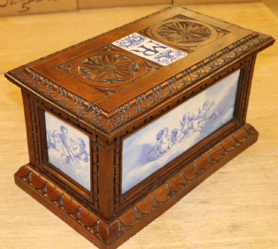 AN ITALIAN CARVED WALNUT AND MAJOLICA CASKET - 3