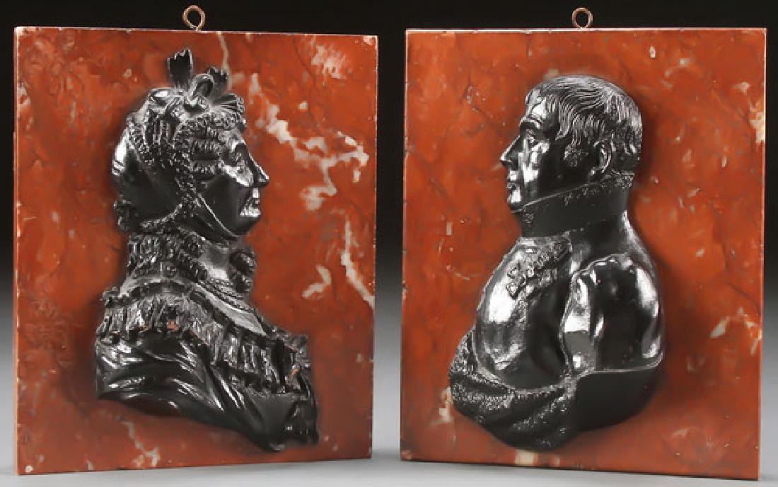 A PAIR OF CAST IRON RELIEF PROFILE BUST PLAQUES