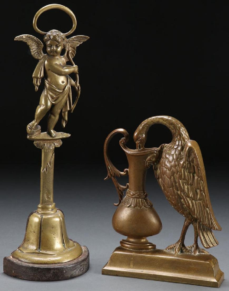 A PAIR OF ENGLISH GILT BRONZE DOORSTOPS