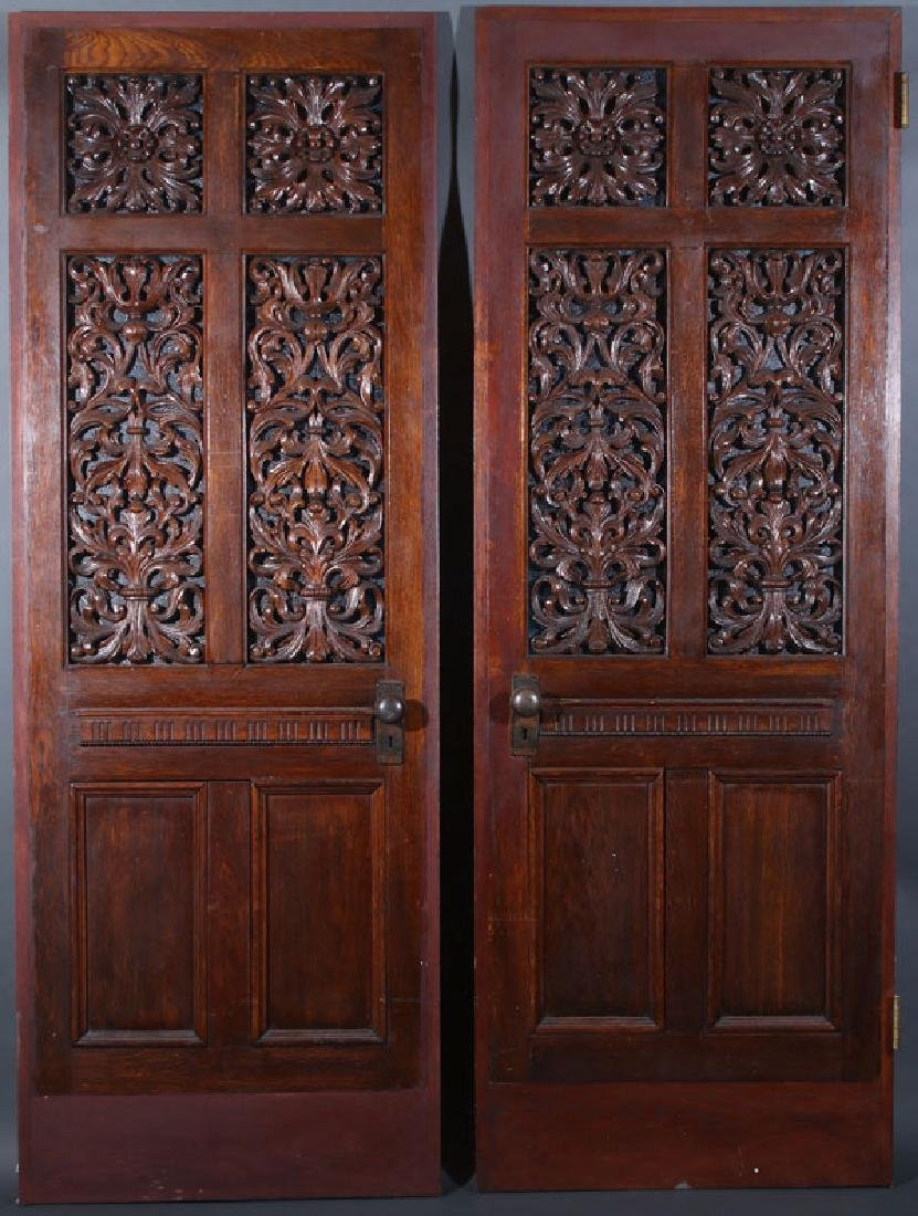 A PAIR OF VICTORIAN OAK PARLOR DOORS, LATE 19TH C
