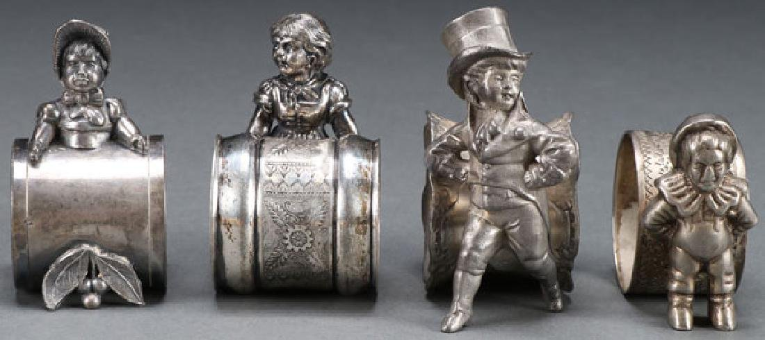 4 VICTORIAN SILVERPLATE FIGURAL NAPKIN RINGS