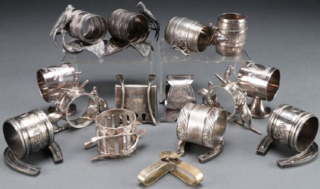 A GROUP OF 14 SILVER PLATE NAPKIN RINGS