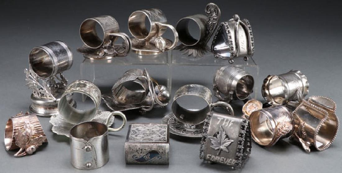 A GROUP OF 16 SILVER PLATE FIGURAL NAPKIN RINGS