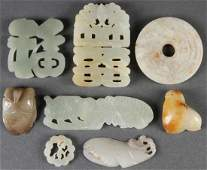 A GROUP OF EIGHT CHINESE CARVED JADE ORNAMENTS