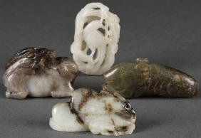 A Group Of Four Chinese Carved Jade Ornaments