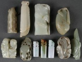A Group Of Eleven Chinese Carved Jade Ornaments