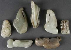 A GROUP OF SEVEN CHINESE CARVED JADE ORNAMENTS