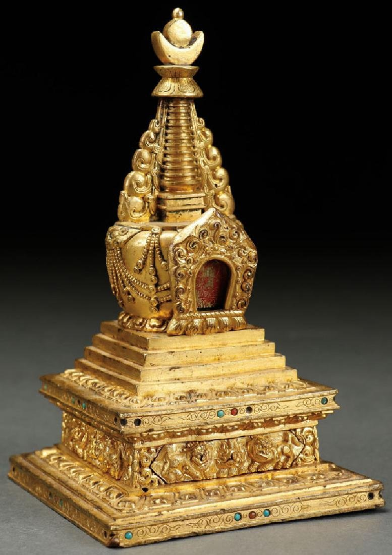 A VERY FINE TIBETAN GILT BRONZE AND JEWELED STUPA
