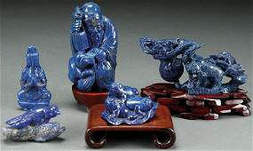 A GROUP OF FIVE CHINESE CARVED BLUE LAPIS FIGURES