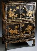 A CHINESE GILT DECORATED BLACK LACQUER AND BRONZE