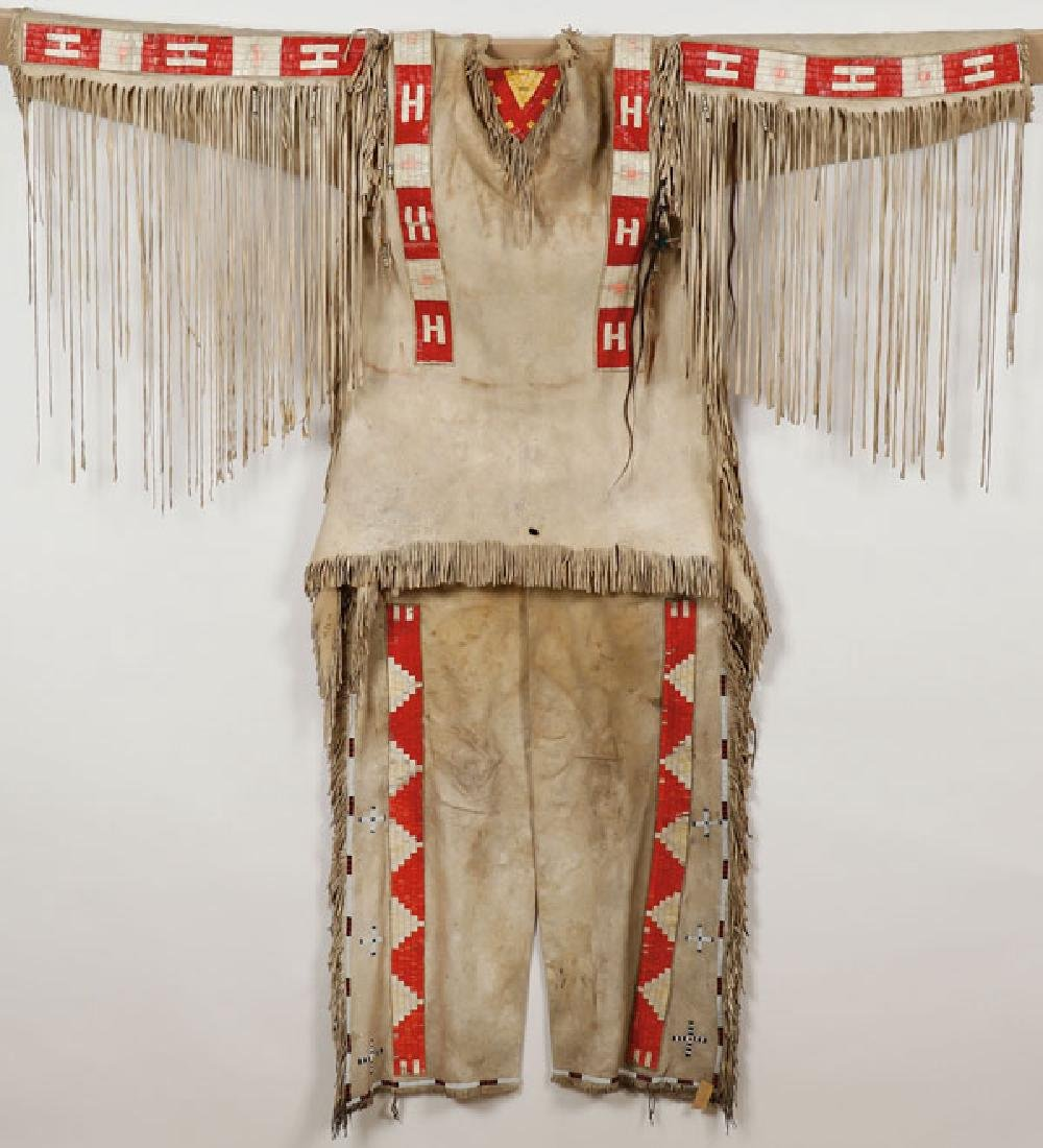 A SIOUX BEADED AND QUILLED HIDE MAN'S WAR SHIRT