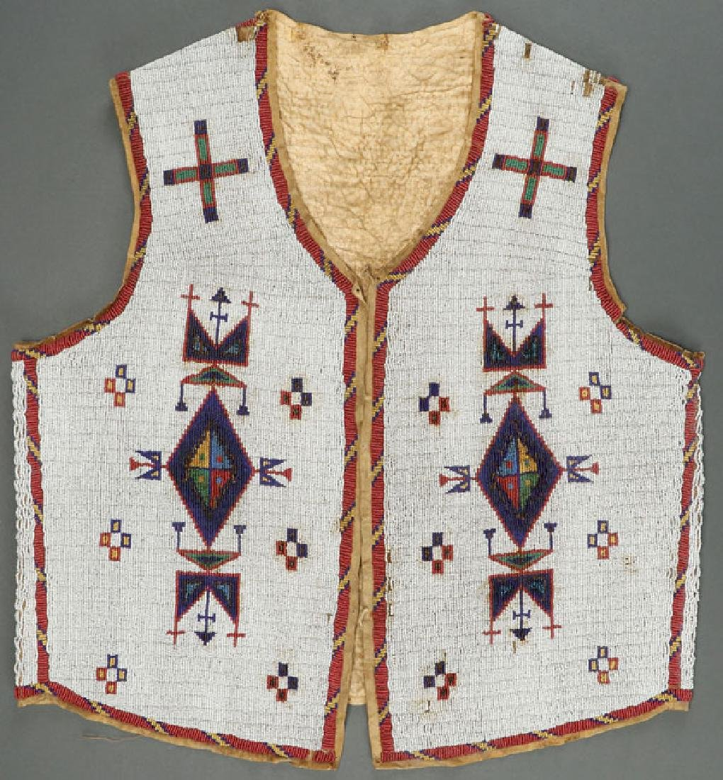 A SIOUX MANS BEADED HIDE VEST, CIRCA 1890