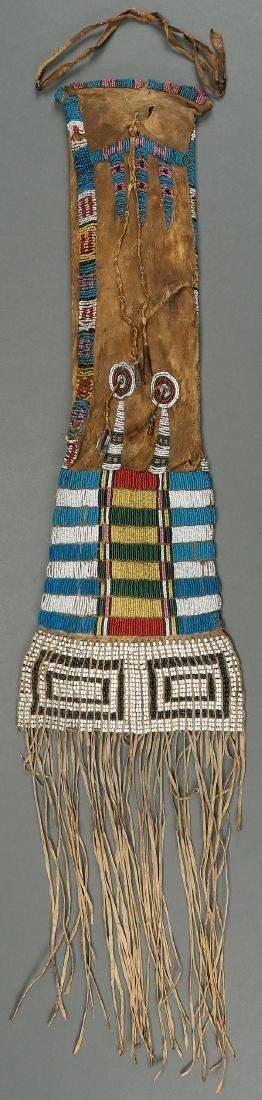 A GOOD PLAINS BEADED HIDE PIPE-BAG 19TH CENTURY