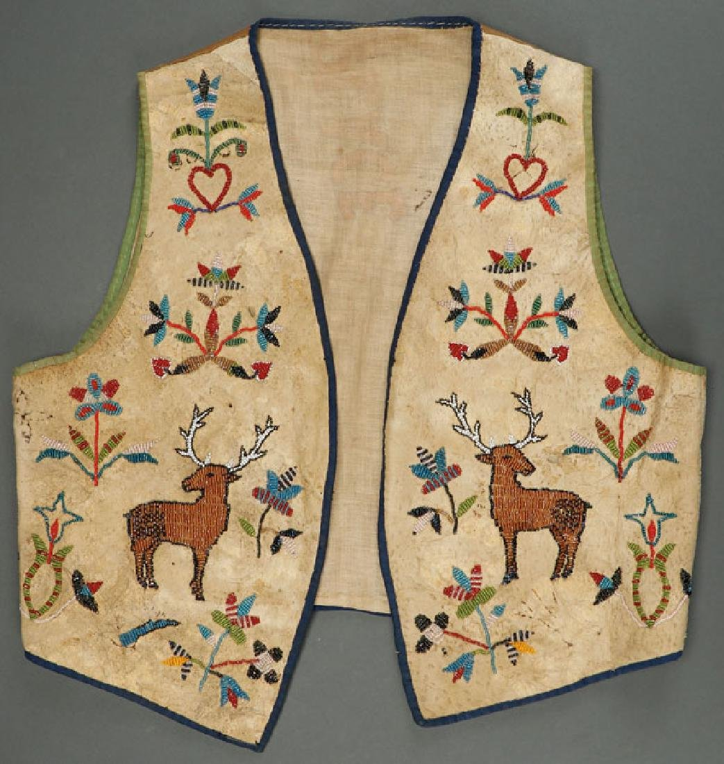 A PROBABLY SANTEE SIOUX BEADED HIDE VEST