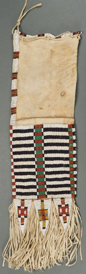 A VERY FINE SIOUX BEADED HIDE PIPE BAG