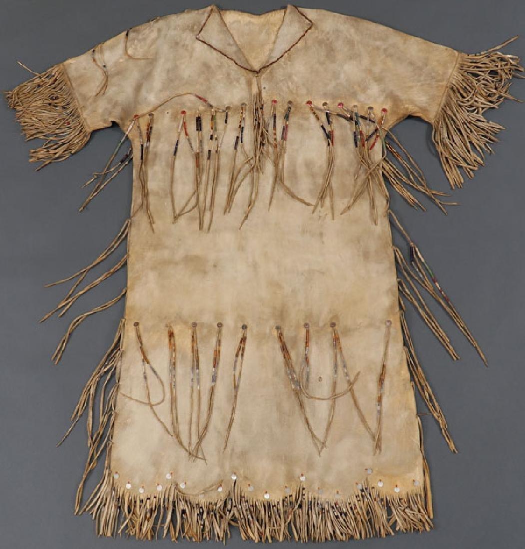 A PLATEAU ELK HIDE DRESS, CIRCA 1910