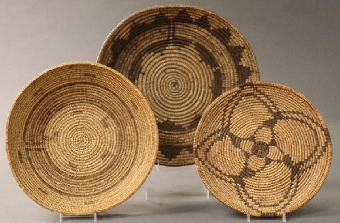 A GROUP OF THREE SOUTHWEST WOVEN BASKETS