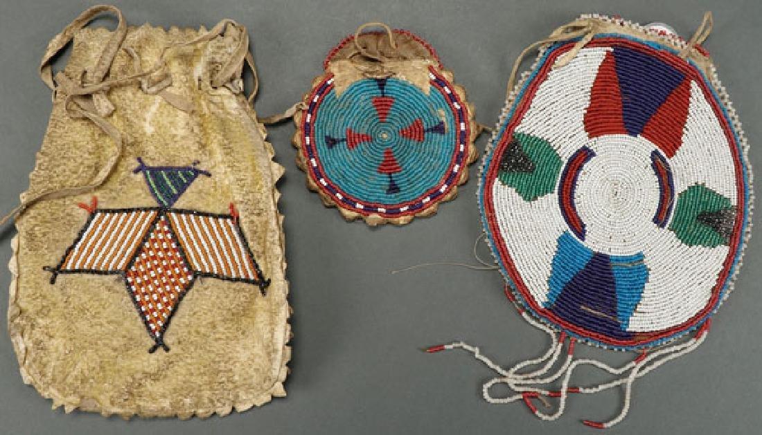 THREE BEADED HIDE BAGS, CIRCA 1900-1920