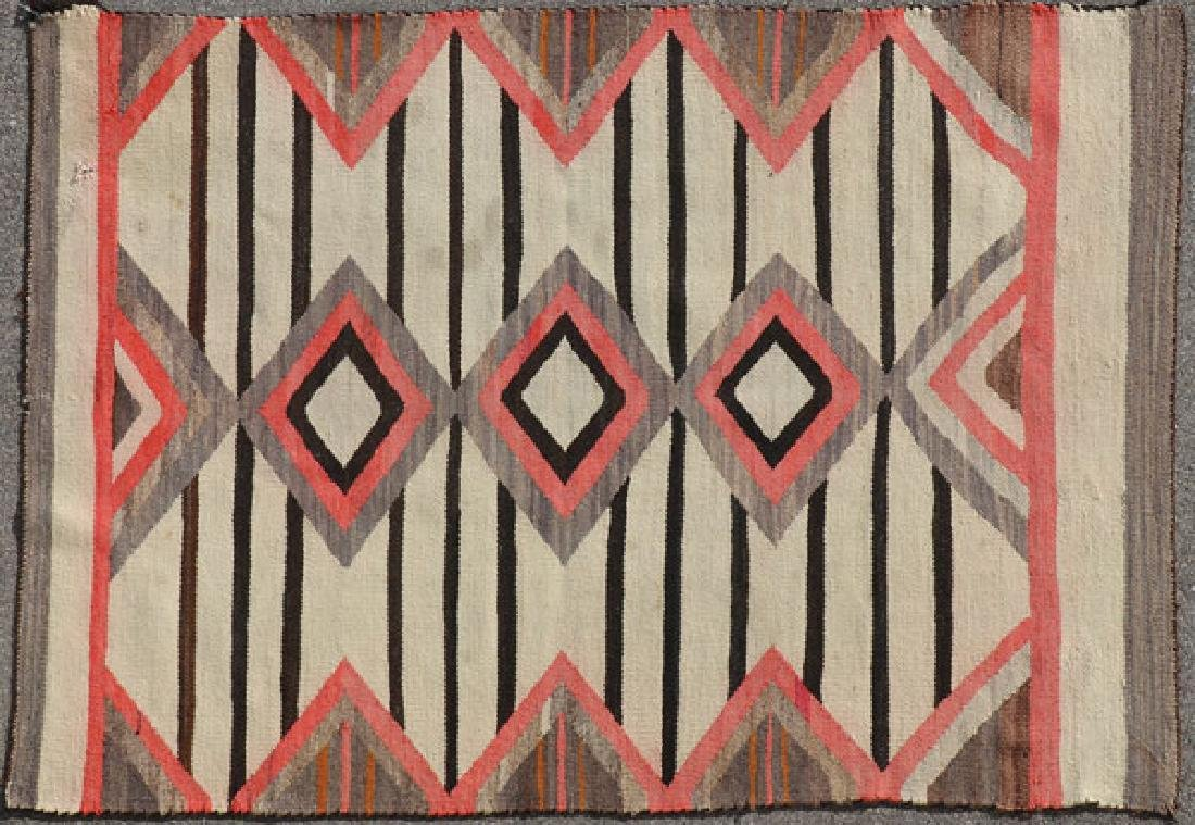 FOUR NAVAJO RUGS, LIKELY 1ST HALF OF THE 20TH C