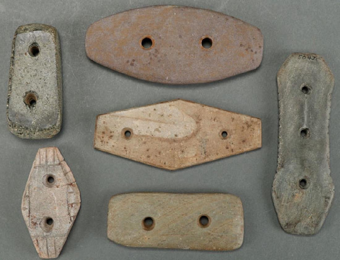 A GROUP OF SIX STONE GORGET PENDANTS