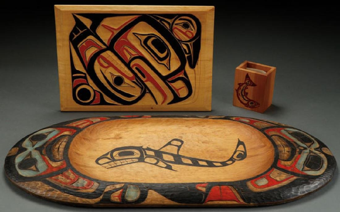 A PAIR OF NORTHWEST COAST CARVED RELIEF PLAQUES