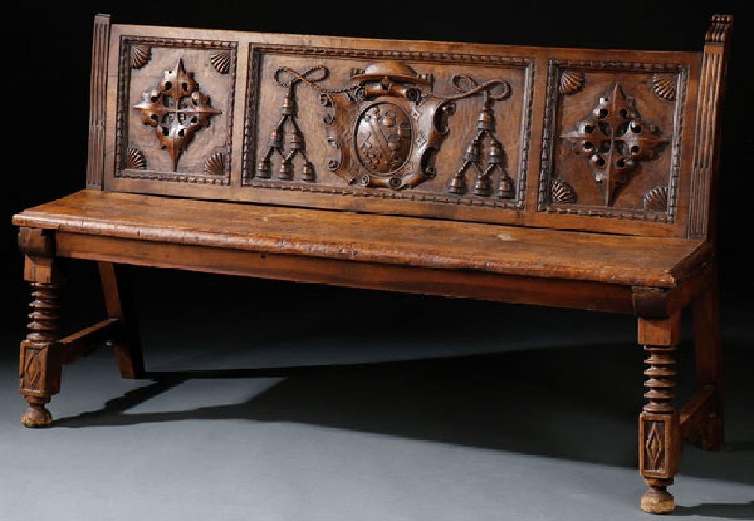A FRENCH RENAISSANCE CARVED WALNUT BENCH