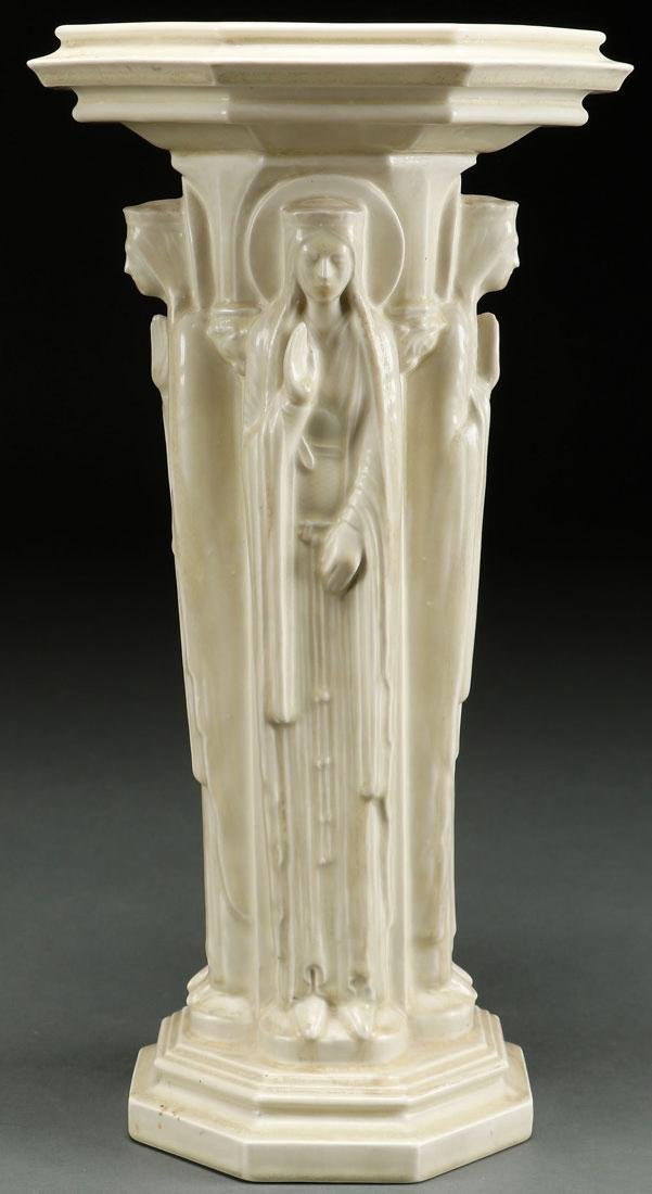A RARE ROOKWOOD GOTHIC STYLE FIGURAL CANDLE STAND