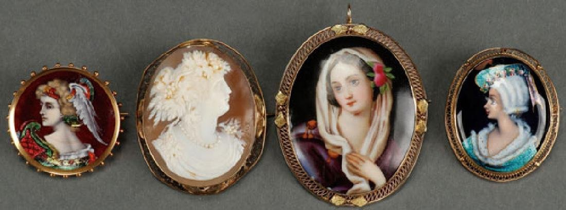 A GROUP OF GOLD MOUNTED MINIATURE PORTRAITS