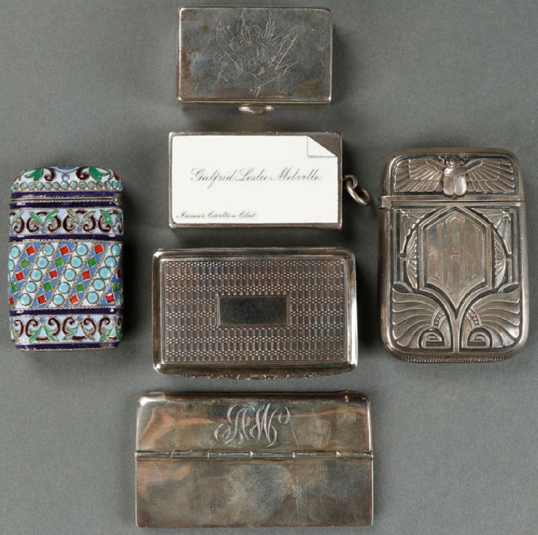 A GROUP OF SILVER AND ENAMELED CASES AND BOXES