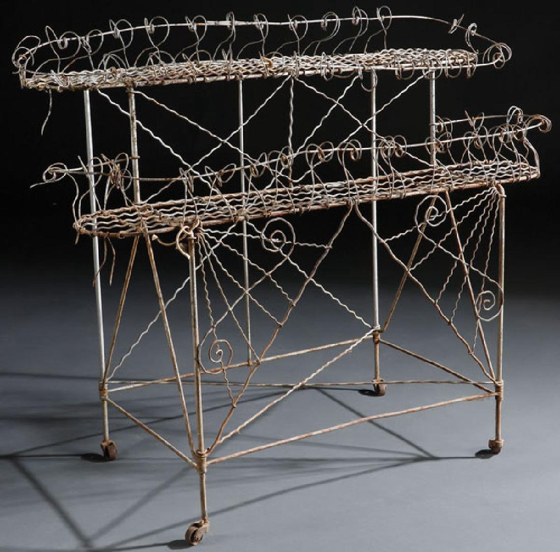 a victorian bent and woven wire plant stand