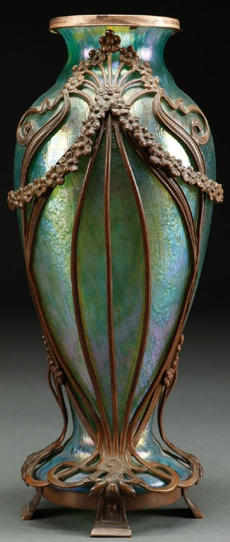A BOHEMIAN IRIDIZED GLASS AND BRONZE MOUNTED VASE