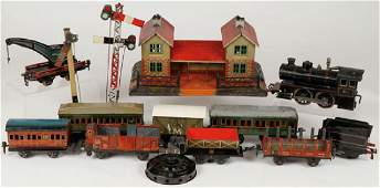 11 PIECE EARLY GERMAN TOY TRAIN AND ACCESSORIES