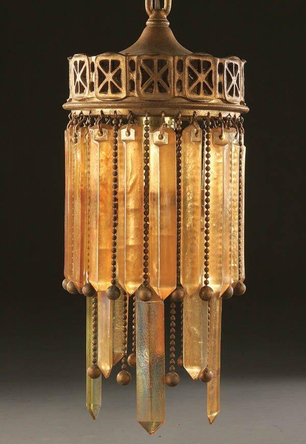 730: A FINE TIFFANY GLASS AND BRONZE HALL LAMP circa 1