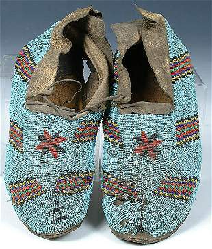 A PAIR OF MENS CHEYENNE BEADED MOCCASINS c.1900.