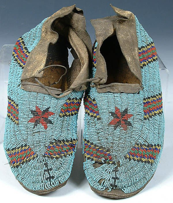 1: A PAIR OF MENS CHEYENNE BEADED MOCCASINS c.1900.