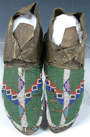 A PAIR OF LADIES NORTHERN PLAINS BEADED MOCCASINS